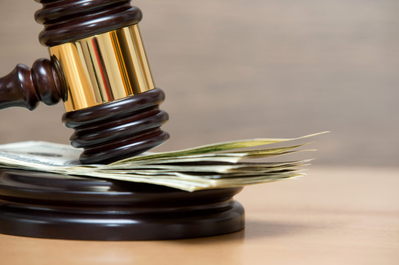 Law gavel on a stack of money