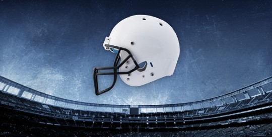 football helmet with stadium background